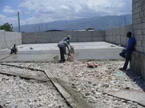 Réhabilitation des infrastructures pour préparer la rentrée scolaire, bidonville de Cité Soleil en Haïti
