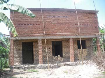 Maison communautaire en construction, association de parents Tabarabana au Rwanda
